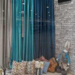 Декоративные подушки наших дизайнеров в витрине магазина в ЦДМ