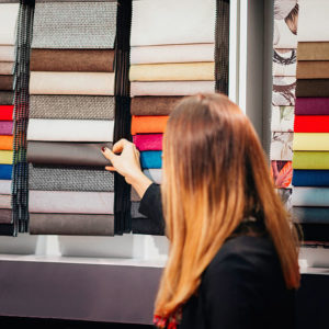 Designer looking fabric swatches in the store
